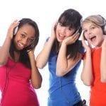 Teen girls listening to music.