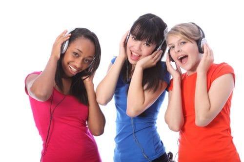 Teenage Girls Singing to music.