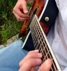 acoustic-guitar-lessons-aurora-co-performance-play-music-school